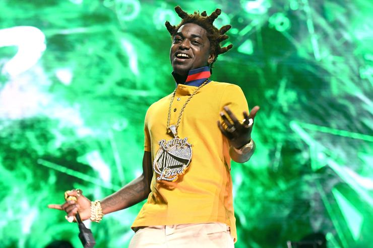 Kodak Black performing in a yellow t-shirt