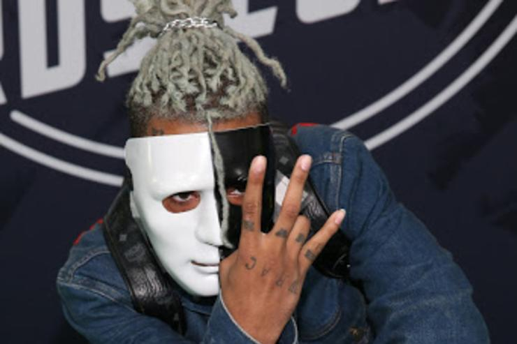 Masked XXXTentacion with a Nintendo Switch