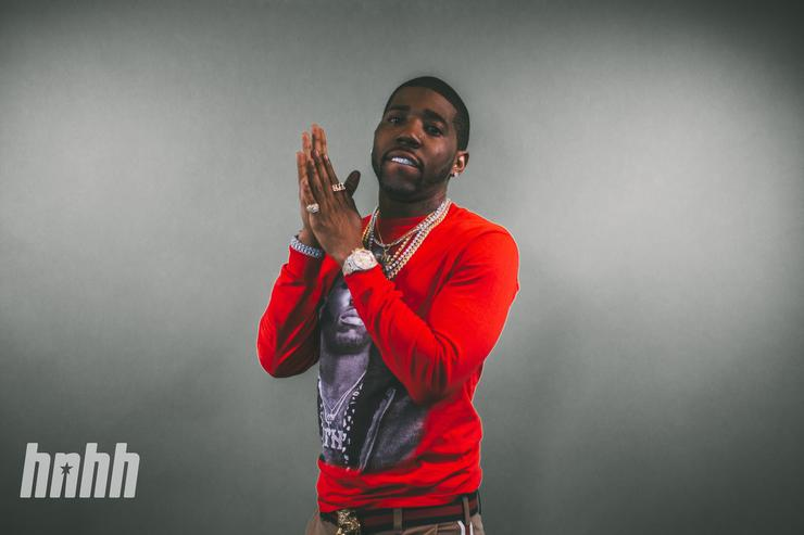 YFN Lucci w prayer hands