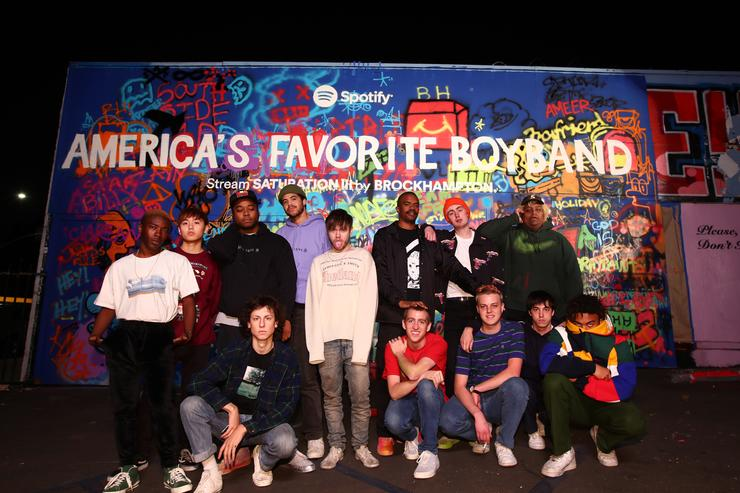 BROCKHAMPTON poses in front of the finished mural at BROCKHAMPTON and Spotify host an event for their biggest fans to celebrate the launch of their new album SATURATION III on December 15, 2017 in Los Angeles, California