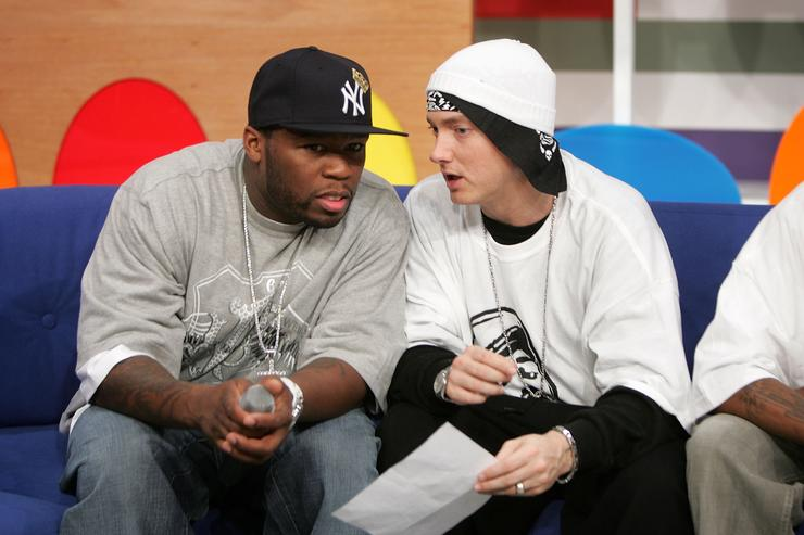 50 Cent and Eminem appear onstage during BET's 106 & Park December 4, 2006 in New York City