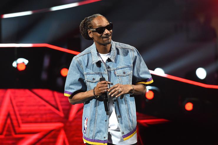 Snoop Dogg speaks onstage prior to the 2018 Taco Bell Skills Challenge at Staples Center on February 17, 2018 in Los Angeles, California.