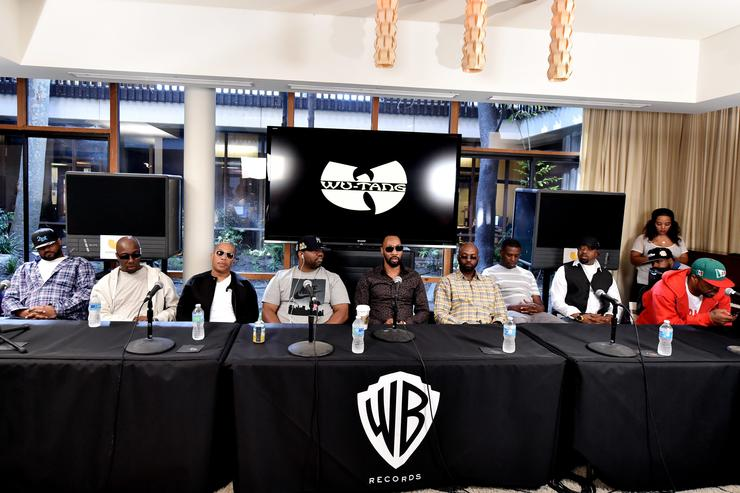 Rappers Ghostface Killah, Inspectah Deck, U-God, Raekwon, RZA, Masta Killa, GZA, Cappadonna and Method Man of the Wu-Tang Clan pose at a press conference to announce they have signed with Warner Bros. Records at Warner Bros. Records on October 2, 2014 in Burbank, California.