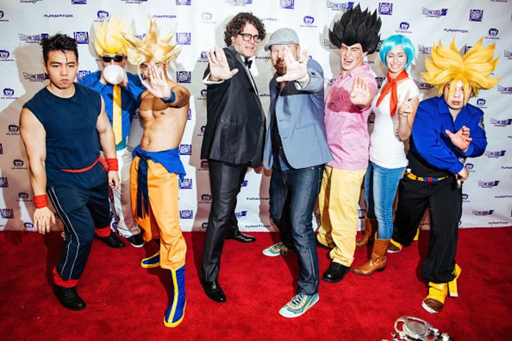 : Christopher Sabat (L) and Sean Schemmel pose with fans in costumes at the 'Dragon Ball Z: Resurrection 'F'' premiere at AMC Empire 25 theater on August 3, 2015 in New York City