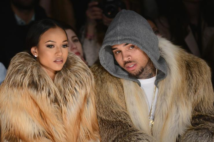 Karrueche Tran and Chris Brown attends the Michael Costello fashion show during Mercedes-Benz Fashion Week Fall 2015 at The Salon at Lincoln Center on February 17, 2015 in New York City