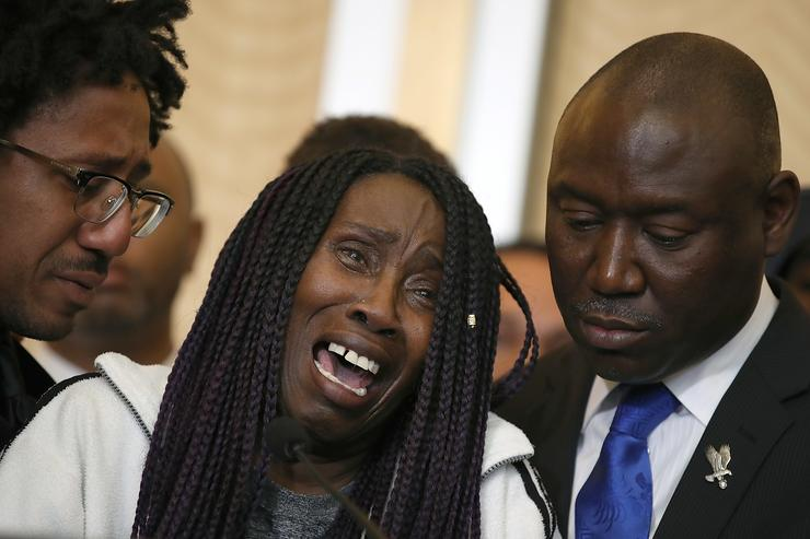 Sequita Thompson, (C) grandmother of Stephon Clark who was shot and killed by Sacramento police, cries during a news conference with civil rights attorney Ben Crump on March 26, 2018 in Sacramento, California. The family of Stephon Clark, an unarmed black man who was shot and killed by Sacramento police officers, have hired civil rights attorney Ben Crump to represent the Clark family in a wrongful death suit against the Sacramento police department.