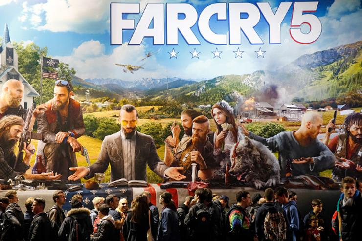 Visitors queue to play the video game 'Far Cry 5' developed and published by Ubisoft during the 'Paris Games Week' on November 01, 2017 in Paris, France.