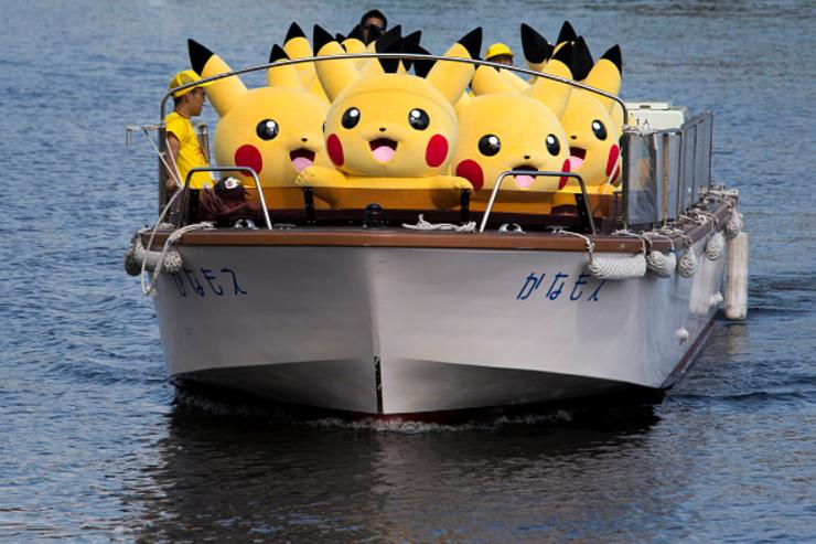 Performers dressed as Pikachu, a character from Pokemon series game titles, ride on a boat during the Pikachu Outbreak event hosted by The Pokemon Co. on August 9, 2017 in Yokohama, Kanagawa, Japan.