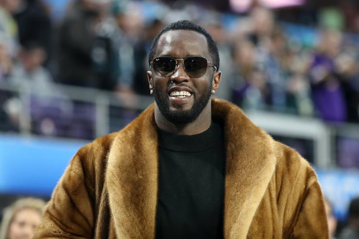 Rapper Sean 'Diddy' Combs looks on during warm-ups prior to Super Bowl LII between the New England Patriots and the Philadelphia Eagles at U.S. Bank Stadium on February 4, 2018 in Minneapolis, Minnesota.