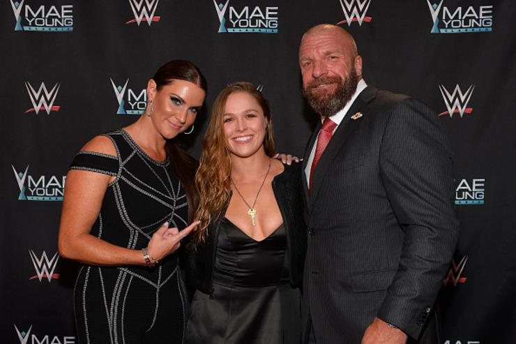 WWE Chief Brand Officer Stephanie McMahon, MMA fighter Ronda Rousey and WWE Executive Vice President of Talent, Live Events and Creative Paul 'Triple H' Levesque appear on the red carpet of the WWE Mae Young Classic on September 12, 2017 in Las Vegas, Nevada.