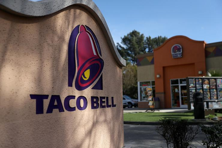 A sign is posted in front of a Taco Bell restaurant on February 22, 2018 in Novato, California. Taco Bell has become the fourth-largest domestic restaurant brand by edging out Burger King. Taco Bell sits behind the top three restaurant chains McDonald's, Starbucks and Subway.