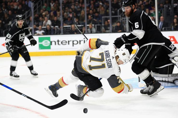 Jake Muzzin #6 of the Los Angeles Kings defends against William Karlsson #71 of the Vegas Golden Knights during the third period in Game Three of the Western Conference First Round during the 2018 NHL Stanley Cup Playoffs at Staples Center on April 15, 2018 in Los Angeles, California.