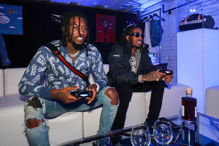 Rappers Offest (L) and Quavo play XBOX at the H.O.M.E. by Martell event on November 29, 2017 in Detroit, Michigan.