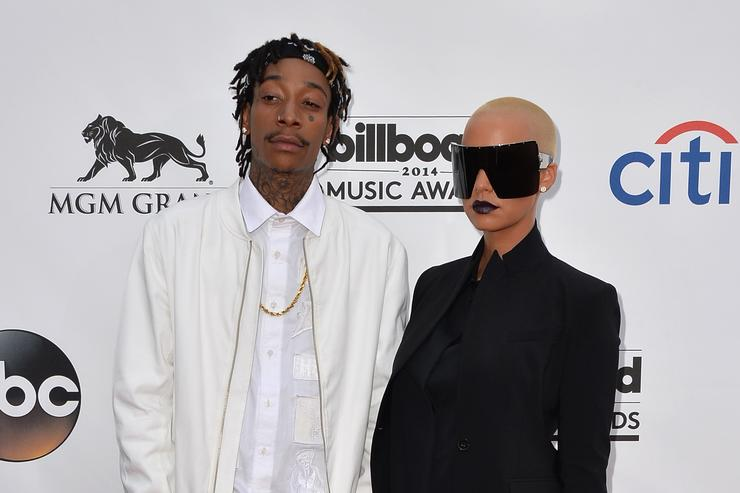 Wiz Khalifa (L) and model Amber Rose attend the 2014 Billboard Music Awards at the MGM Grand Garden Arena on May 18, 2014 in Las Vegas, Nevada