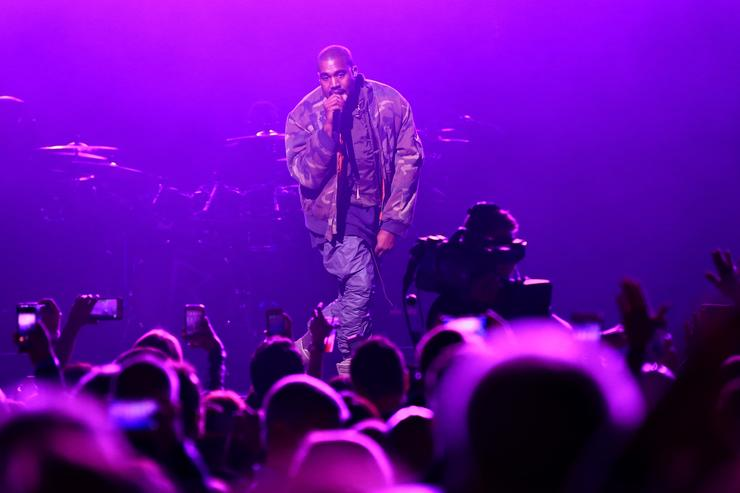 Kanye West performs onstage during DirecTV Super Saturday Night hosted by Mark Cuban's AXS TV and Pro Football Hall of Famer Michael Strahan at Pendergast Family Farm on January 31, 2015 in Glendale, Arizona