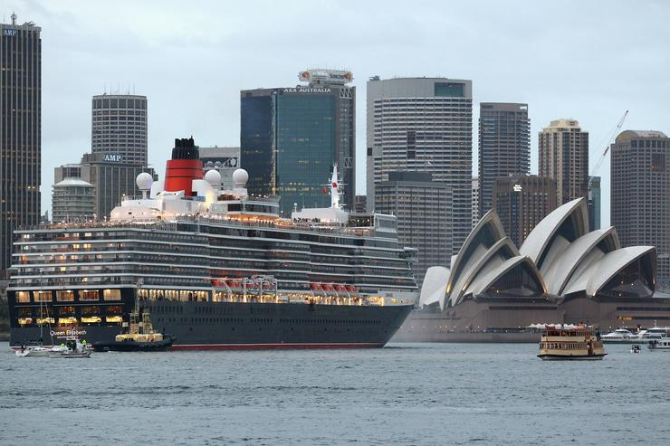 The Queen Elizabeth cruises past the Sydney Opera House in Sydney Harbour on February 22, 2011 in Sydney, Australia. The voyage marks the new Queen Elizabeth's first voyage to Sydney and the first time the two Cunard liners have arrived at the same time to the Sydney Harbour. Sydney is the first of three Australian ports for the Queen Elizabeth and the last for the Queen Mary II which will depart for Christchurch on February 23
