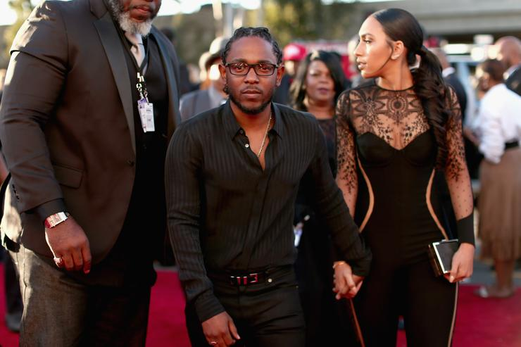 Kendrick Lamar (C) and Whitney Alford attend The 58th GRAMMY Awards at Staples Center on February 15, 2016 in Los Angeles, California
