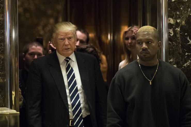 Donald Trump and Kanye West exit an elevator and walk into the lobby at Trump Tower, December 13, 2016 in New York City
