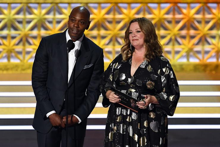 Comedian Dave Chappelle (L) and actor Melissa McCarthy speak onstage during the 69th Annual Primetime Emmy Awards at Microsoft Theater on September 17, 2017 in Los Angeles, California.