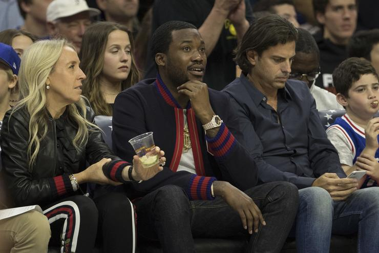 Musical artist Meek Mill watches the game between the Boston Celtics and Philadelphia 76ers at the Wells Fargo Center on October 20, 2017 in Philadelphia, Pennsylvania. The Celtics defeated the 76ers 102-92.
