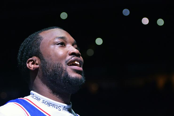 Meek Mill looks to the crowd before the game before the Philadelphia 76ers and Miami Heat at Wells Fargo Center on April 24, 2018 in Philadelphia, Pennsylvania