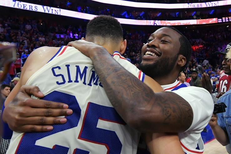 Ben Simmons #25 of the Philadelphia 76ers hugs entertainer Meek Mill after the game against the Miami Heat at Wells Fargo Center on April 24, 2018 in Philadelphia, Pennsylvania. The 76ers won 104-91.