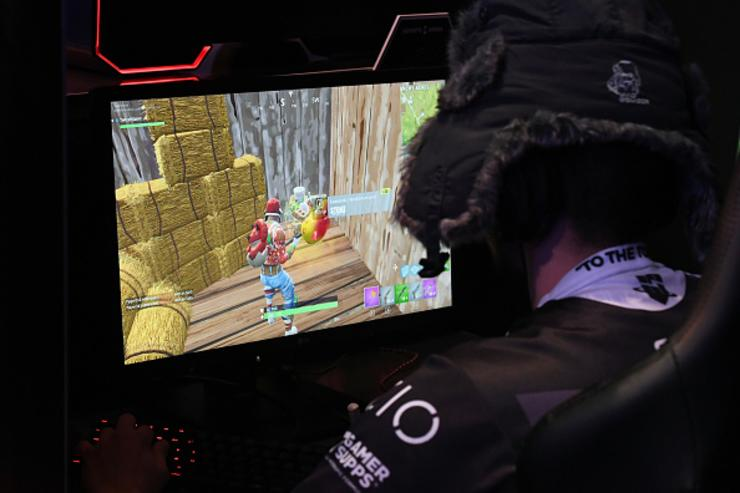 A gamer plays 'Fortnite' against Twitch streamer and professional gamer Tyler 'Ninja' Blevins during Ninja Vegas '18 at Esports Arena Las Vegas on April 21, 2018 in Las Vegas, Nevada.
