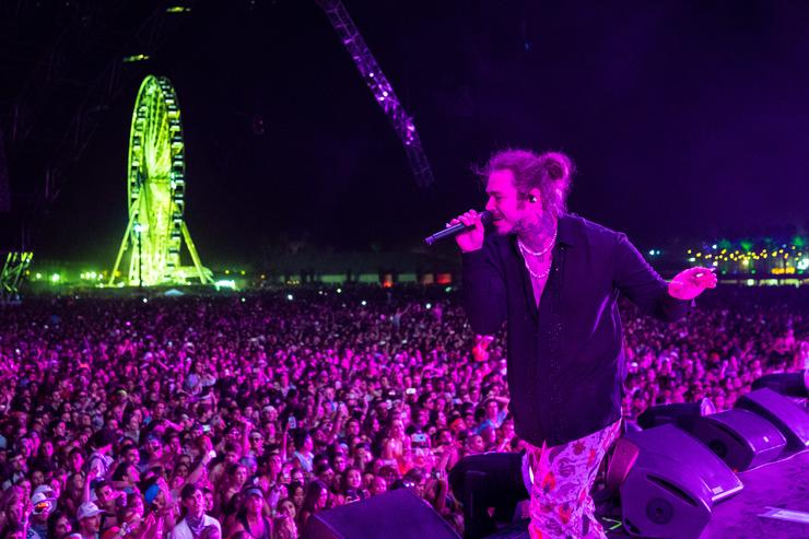 Post Malone performs onstage the 2018 Coachella Valley Music And Arts Festival at the Empire Polo Field on April 14, 2018 in Indio, California