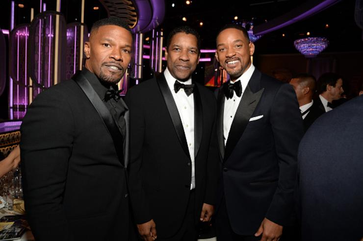 Actors Jamie Foxx, Denzel Washington and Will Smith attend the 73rd Annual Golden Globe Awards held at the Beverly Hilton Hotel on January 10, 2016 in Beverly Hills, California.