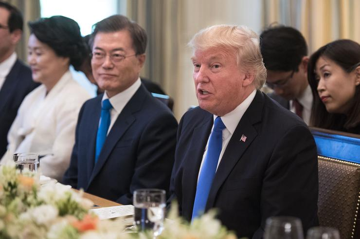 US President Donald Trump (R) and South Korean President Moon Jae-in address the media prior to dinner as Moon's wife Kim Jeong-suk watches, in the State Dinning Room at the White House June 29, 2017 in Washington, D.C.