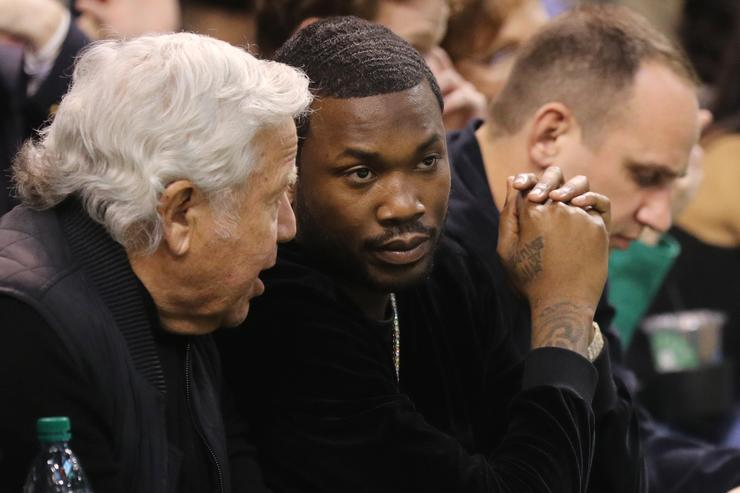 Meek Mill talks with New England Patriots owner Robert Kraft during Game Two of the Eastern Conference Second Round of the 2018 NBA Playoffs between the Boston Celtics and the Philadelphia 76ers at TD Garden on May 3, 2018 in Boston, Massachusetts