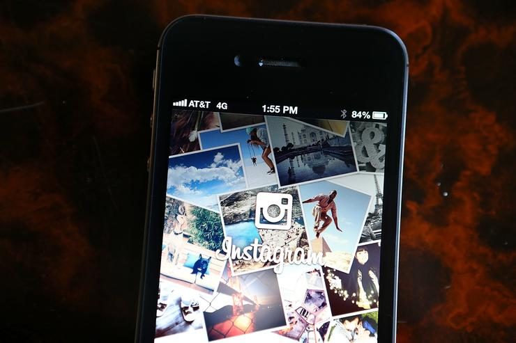The Instagram logo is displayed on an Apple iPhone on December 18, 2012 in Fairfax, California. Users of the popular photo-sharing app Instagram are angered over language in Instagram's new terms of service that states that a business may use any of the users photographs in advertising without compensation to the user. The policy is set to go into effect on January 16, 2013.