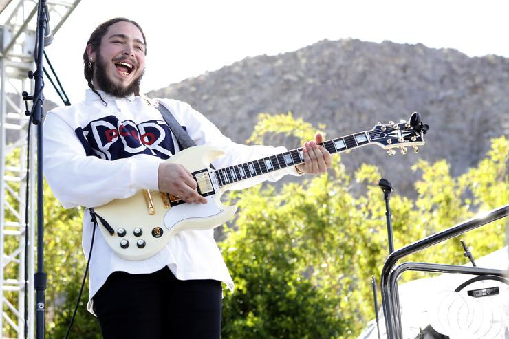Post Malone performs on stage at the Coachella Republic Records Jaegermeister Party at Republic House on April 17, 2016 in Palm Springs, California.