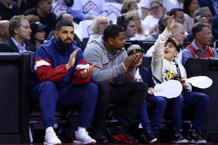 Drake looks on from his court side seat in the first half of Game Two of the Eastern Conference Semifinals between the Cleveland Cavaliers and the Toronto Raptors during the 2018 NBA Playoffs at Air Canada Centre on May 3, 2018 in Toronto, Canada