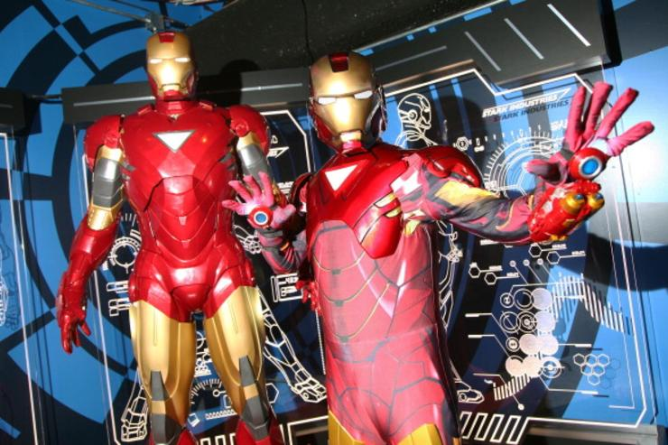 A costumed Iron Man (right) poses with a wax figure of Iron Man (left) at the Madame Tussauds New York's Interactive Marvel Super Hero Experience at Madame Tussauds on April 26, 2012 in New York City.