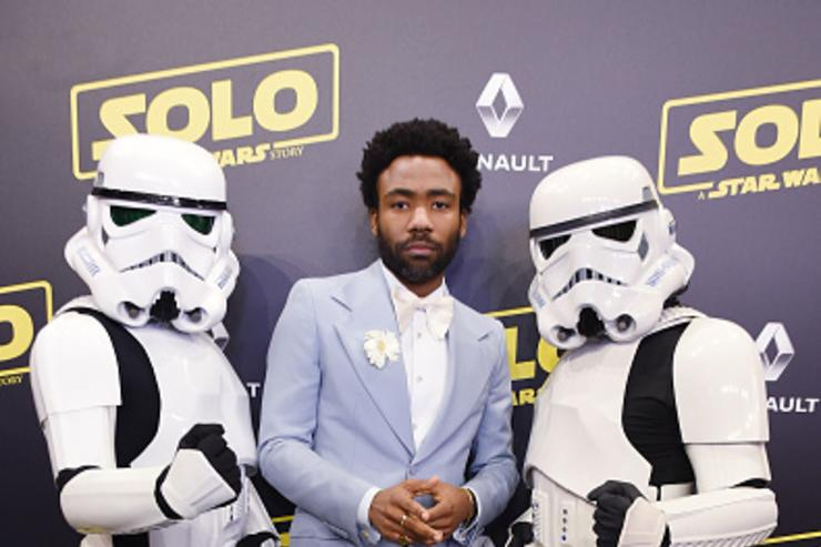 Actor Donald Glover and Stormtroopers attend a 'Solo: A Star Wars Story' party at the Carlton Beach following the film's out of competition screening during the 71st International Cannes Film Festival at Carlton Beach on May 15, 2018 in Cannes, France.