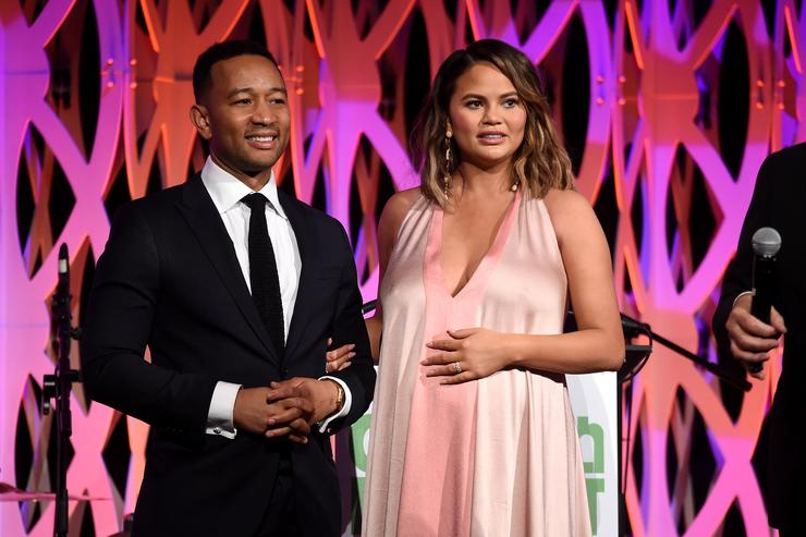 John Legend (L) and Chrissy Teigen speak onstage during City Harvest's 35th Anniversary Gala at Cipriani 42nd Street on April 24, 2018 in New York City