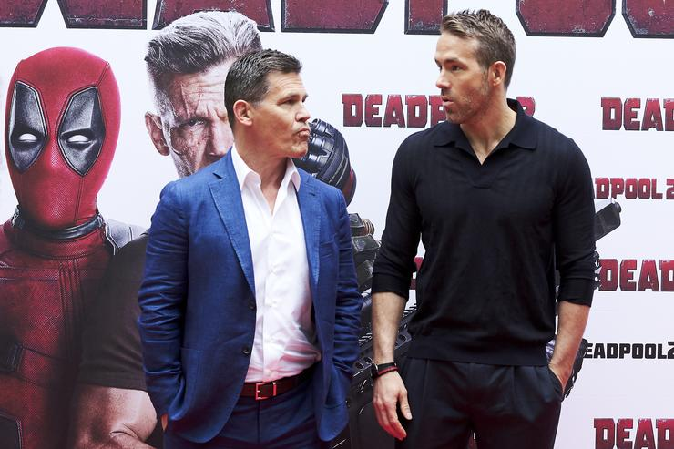 Actors Ryan Reynolds (R) and Josh Brolin (L) attend 'Deadpool 2' photocall at the Villamagna Hotel on May 7, 2018 in Madrid, Spain.