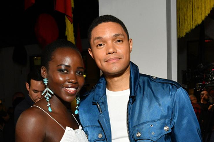 Actress Lupita Nyong'o and TV host Trevor Noah attend the Calvin Klein Collection fashion show during New York Fashion Week on September 7, 2017 in New York City.