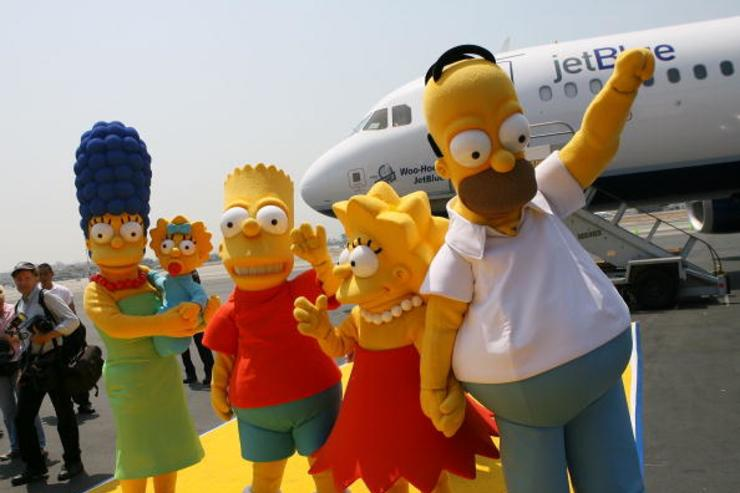 Actors dressed as the television cartoon characters from 'The Simpson' pose at the unveiling of Jet Blue's 'Simpson's' themed airplane at the Burbank Airport on July 17, 2007 in Burbank, California.