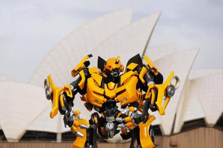 Transformers robot Bumblebee, which stands at 5 metres tall and weighs 3 tonnes, tours Sydney harbour by barge to launch the DVD of 'Transformers: Revenge Of The Fallen' at Mrs Macquaries Chair on November 5, 2009 in Sydney, Australia.