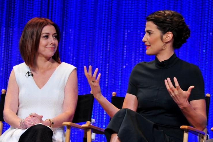 Actors Alyson Hannigan and Cobie Smulders on stage at The Paley Center For Media's PaleyFest 2014 Honoring 'How I Met Your Mother' Series Farewell at Dolby Theatre on March 15, 2014 in Hollywood, California.