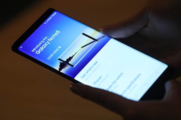 Journalists and bloggers get a closer look at the Galaxy Note 8 smartphone at the Samsung press conference ahead of the IFA consumer electronics fair on August 30, 2017 in Berlin, Germany.