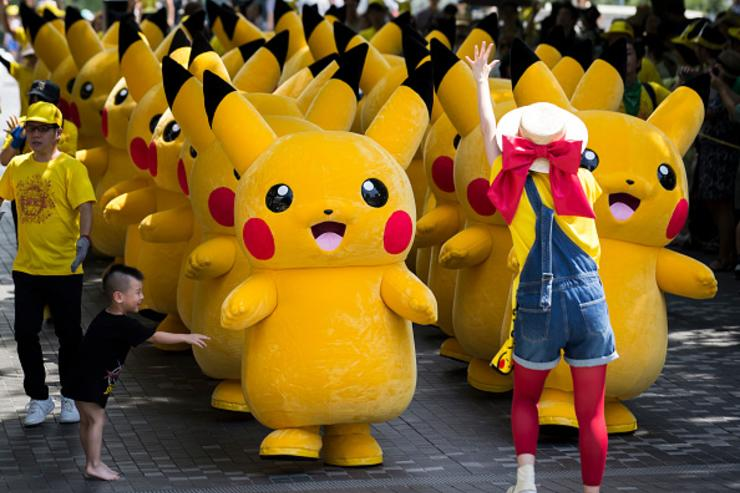 Performers dressed as Pikachu, a character from Pokemon series game titles, march during the Pikachu Outbreak event hosted by The Pokemon Co. on August 9, 2017 in Yokohama, Kanagawa, Japan.