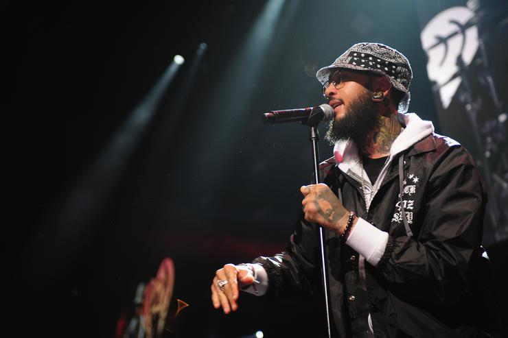 Travie McCoy performs onstage during 103.5 KISS FM's Jingle Ball 2013, presented by Jam Audio Collection, at United Center on December 9, 2013 in Chicago, IL.