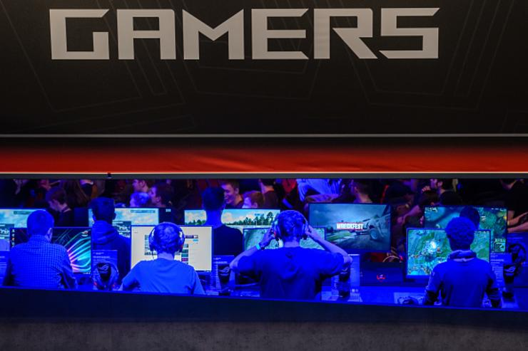 Participants sit at computer monitors to play video games at the 2018 DreamHack video gaming festival on January 27, 2018 in Leipzig, Germany.