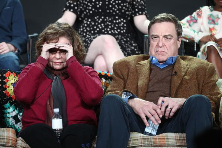 Executive producer/actress Roseanne Barr (L) and actor John Goodman of the television show Roseanne look to the audience from the stage during the ABC Television/Disney portion of the 2018 Winter Television Critics Association Press Tour at The Langham Huntington, Pasadena on January 8, 2018 in Pasadena, California.