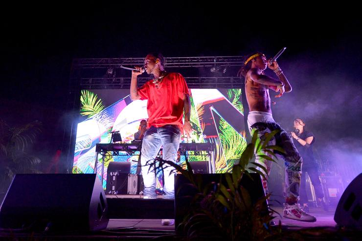 Slim Jxmmi (L) and Swae Lee of Rae Sremmurd perform onstage at Spotify Hosts Sr3mmPocalypse Party with Performances by Rae Sremmurd on May 7, 2018 in Los Angeles, California.