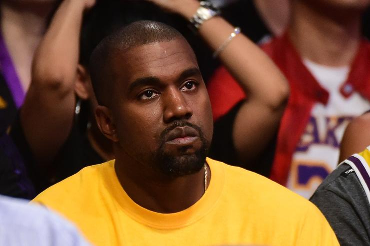 Kanye West looks on as he watches as the Los Angeles Lakers take on the Utah Jazz at Staples Center on April 13, 2016 in Los Angeles, California