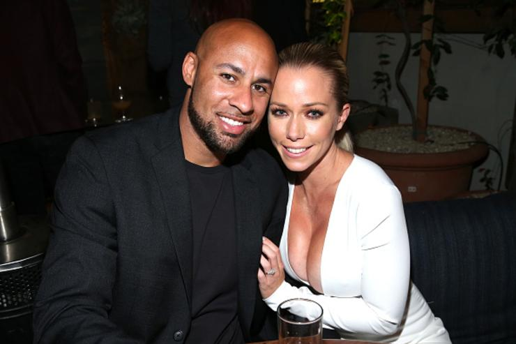 Former professional football player Hank Baskett (L) and TV personality Kendra Wilkinson attend WE tv's premiere of 'Kendra On Top' and 'Driven To Love' at Estrella Sunset on March 31, 2016 in West Hollywood, California.